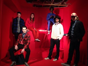 Hentsch Man's showing at the London Collections: Men, with 6 models wearing the AW15 collection set against a bright red background